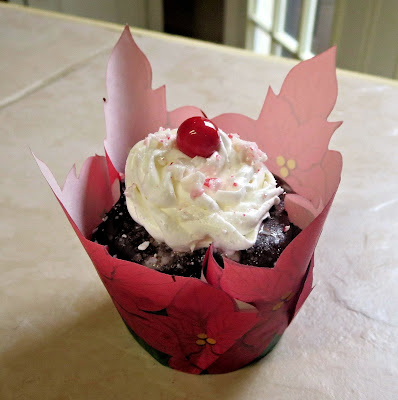 Christmas Chocolate & Peppermint Cupcakes - Close Up of One Cupcake with Poinsettia Wrapper