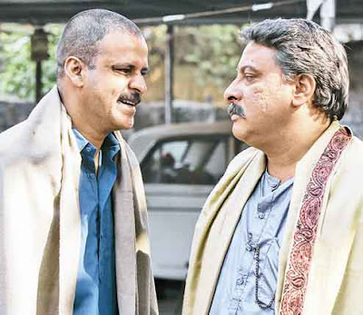 Manoj Bajpai as Sardar Khan, Tigmanshu Dhulia as Ramadhir Singh, Gangs of Wasseypur, directed by Anurag Kashyap