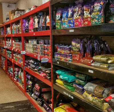 A long shelf filled with high quality Pet food.