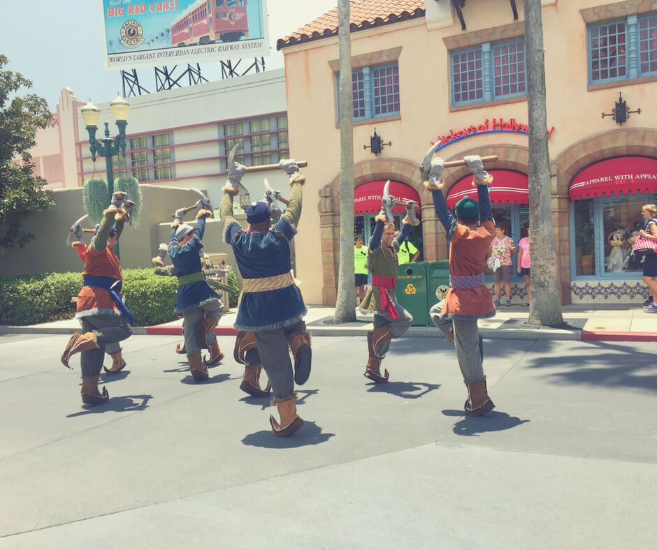 Cast members dance during Frozen parade at Hollywood Studios, Walt Disney World.