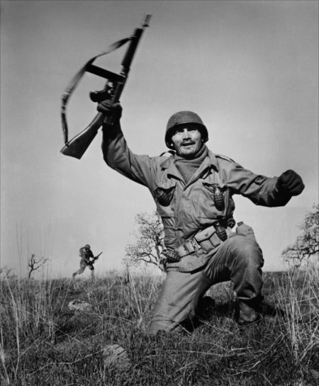 Jack Palance holding machine gun