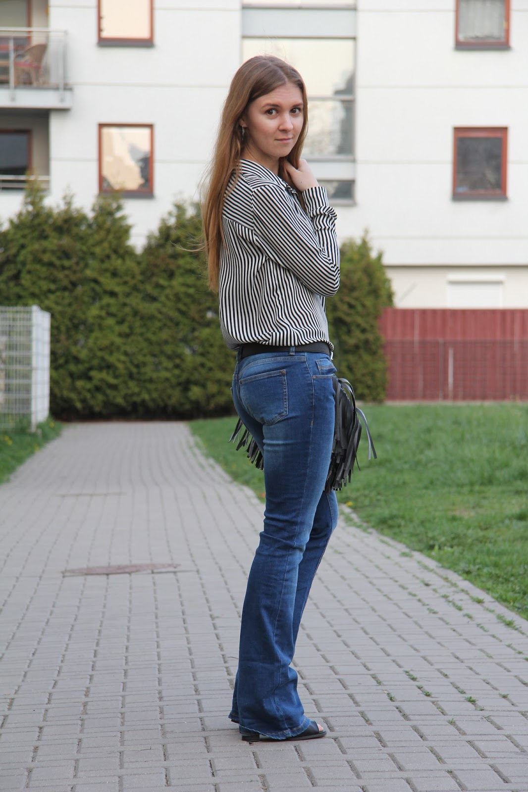 flared jeans and open-toe shoes