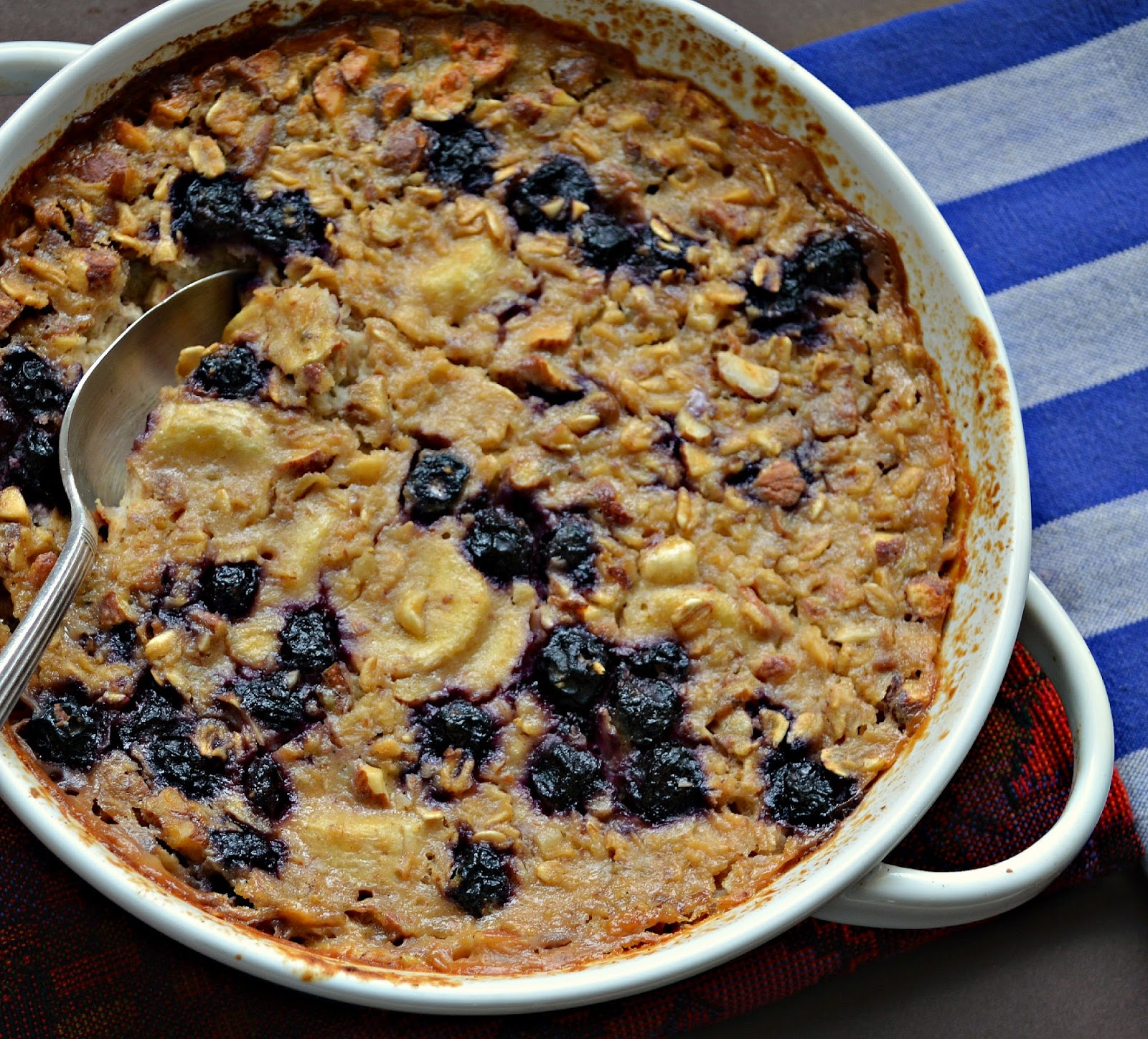 This oatmeal made with applesauce, nuts and fruit is really a great way to start the day! Easy to do and can be made ahead and reheated! #oatmeal #breakfast www.thisishowicook.com