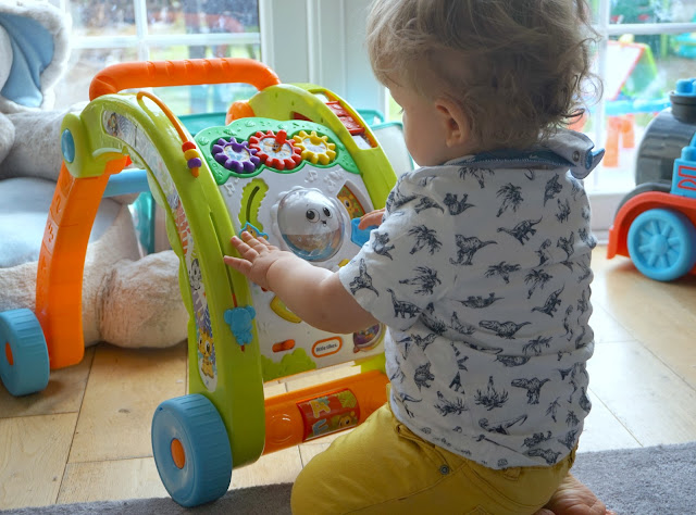 toddler playing with the little tikes 3-in-1 walker