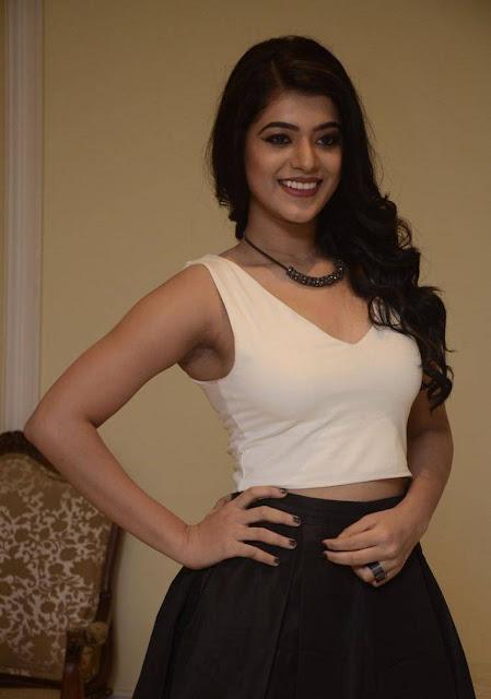 Yamini Bhaskar Latest Hot Cleveage Spicy White Sleveless Tops PhotoShoot Images At Aparatment Movie Audio Launch