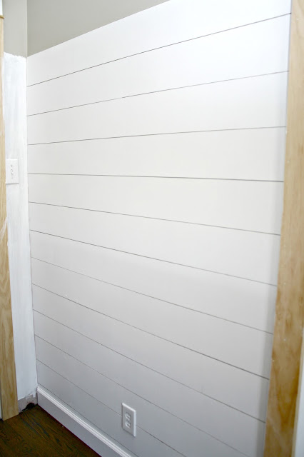 white shiplap wall with spacing