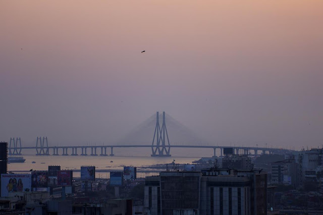 skywatch, sky, colours, bird, bandra worli sealink, buildings, bandra, evening,