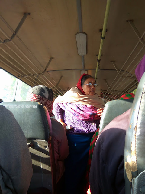 woman, lady, female, bus conductor, Imphal, Manipur, India