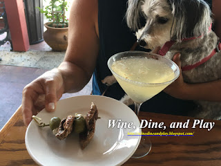 Our dog eyeballs the tenderloin from the black and bleu martini