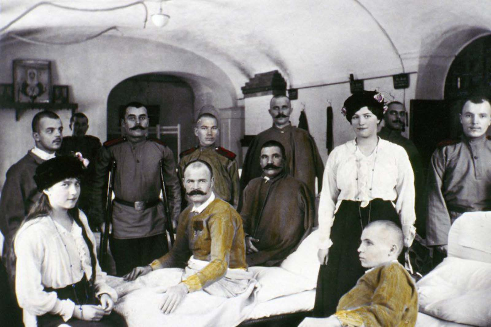 Anastasia (at left) and Maria visit wounded WWI soldiers in hospital.