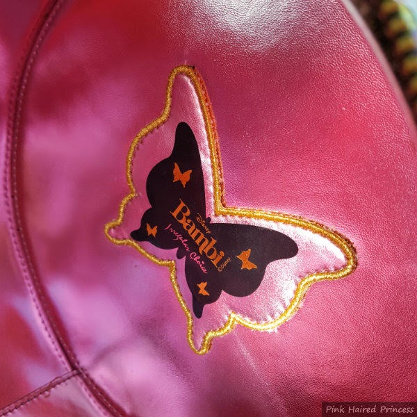 pink metallic lining inside round bag with butterfly label and Disney Bambi Irregular Choice branding