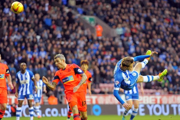 Wigan player Nick Powell scores his side's second goal against Bolton with an overhead kick