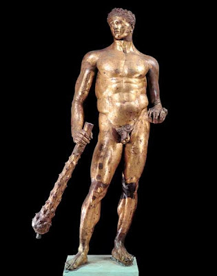 Statue of Hercules in gilded bronze from the 2nd century BC. Hercules is holding a club and a wine cup.