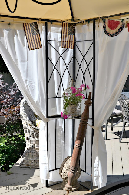 outdoor deck area with wooden spindle