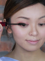 Curl the lashes together, then apply mascara on upper and lower lashes