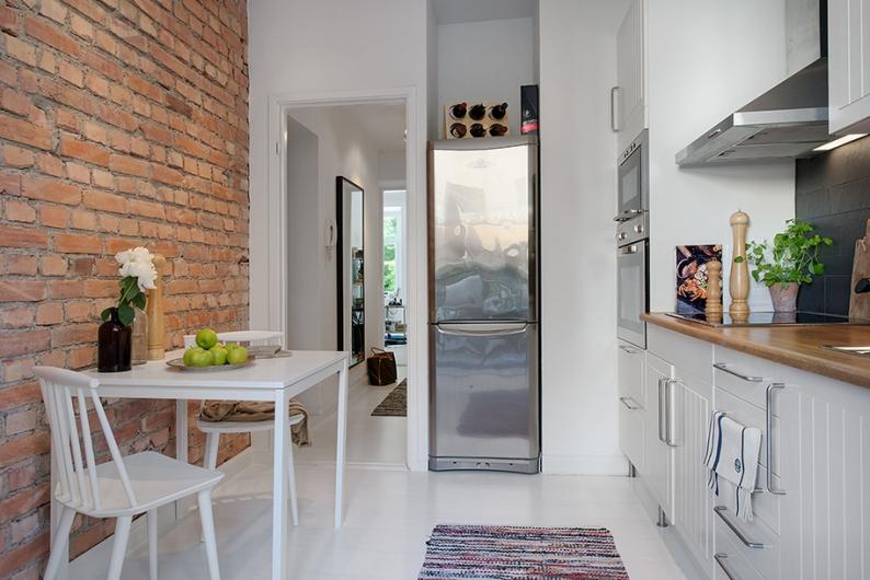 Un apartamento con paredes de ladrillo visto apartment for Acabados apartamentos pequenos