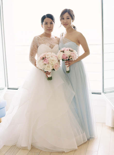 The bride Jin poses with Maid of honor in a light blue dress