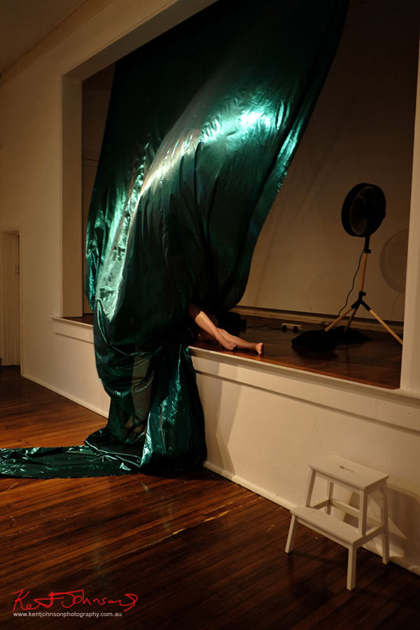 Legs, green fabric, performance of COLLUSIVE MISCELLANY by Amy Claire Mills, Bailee Lobb. Photographed by Kent Johnson for Street Fashion Sydney.