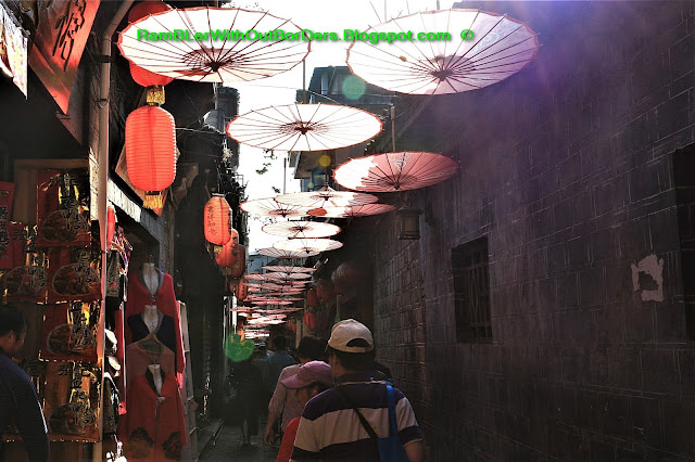 Alley with umbrella, Phoenix Fenghuang County, Hunan, China
