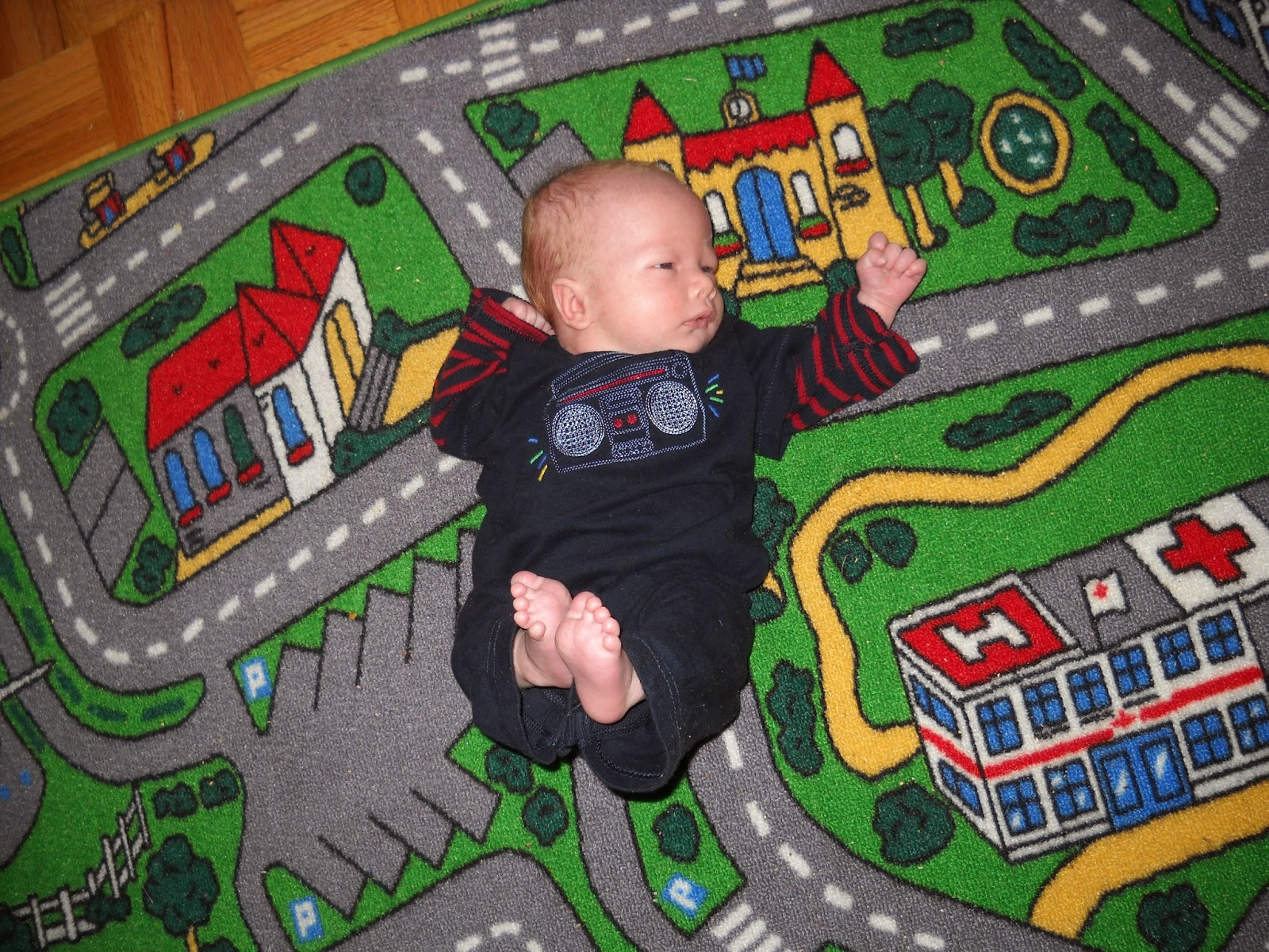 baby on city roads carpet