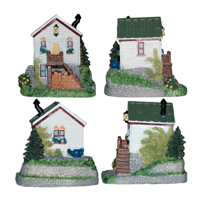 "A small cottage titled ""Mother-in-Law's Cottage"" from the Liberty Falls decorative collection."