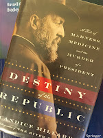 Destiny of the Republic: A Tale of Madness, Medicine and the Murder of a President, by Candice Millard, superimposed on Intermediate Physics for Medicine and Biology.