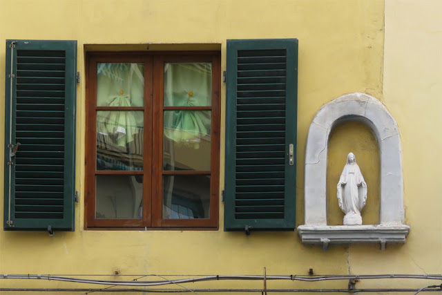 Window with louvered shutters and votive shrine, Via dell'Origine, Livorno