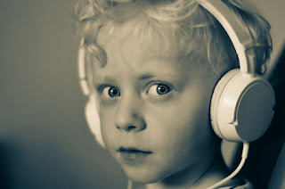 Image: Boy with Headphones, by René Bittner on Pixabay