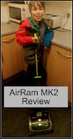 Boy posing with Airram vacuum in kitchen, title text overlayed on top.