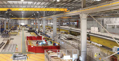 Factory where building sections are assembled before delivery to the site.