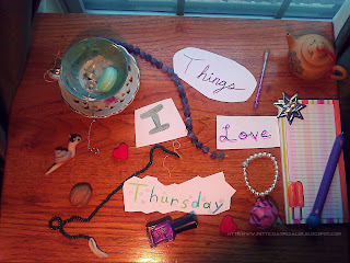 Collage on a wooden surface filled with beads, hearts, natural stones, and other things.  Words read: Things I Love Thursday