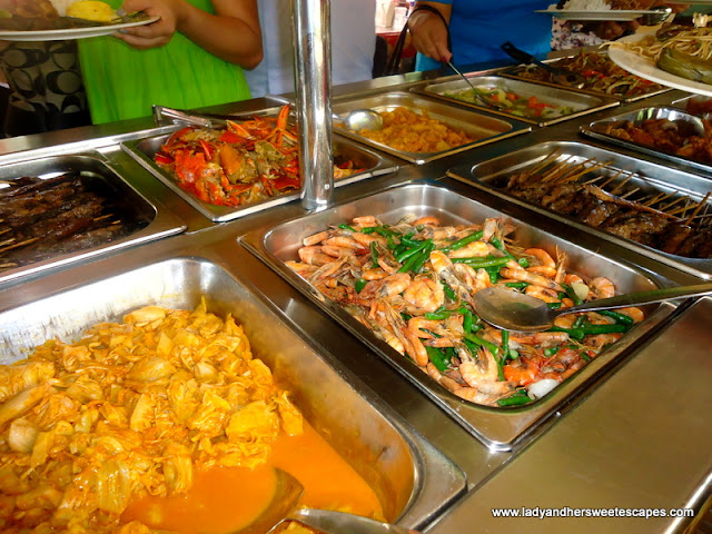 different sumptuous foods inside the boat