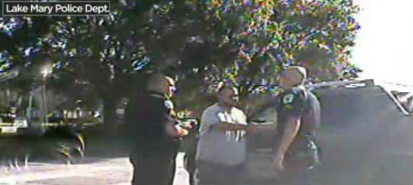 Lake Mary police shake George Zimmerman's hand.