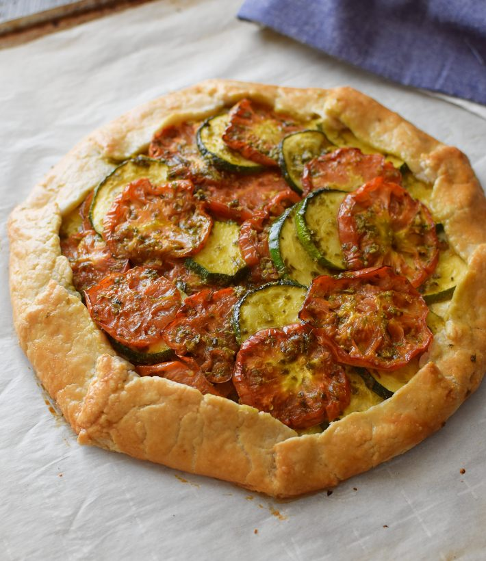 Tomato zucchini galette with feta and pesto