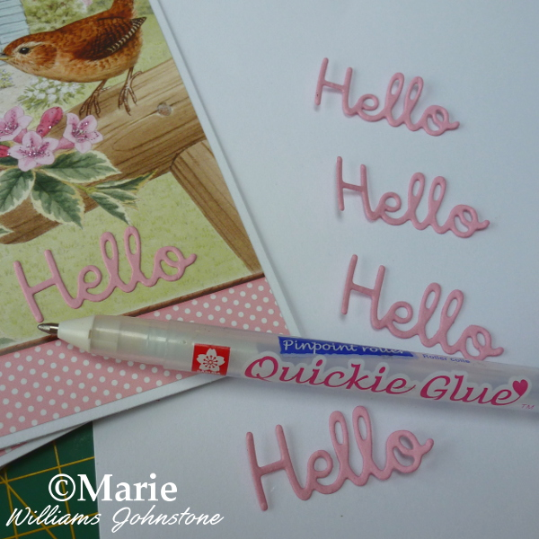 Adding a Hello die cut word to a handmade card notecard with Quickie Glue pen