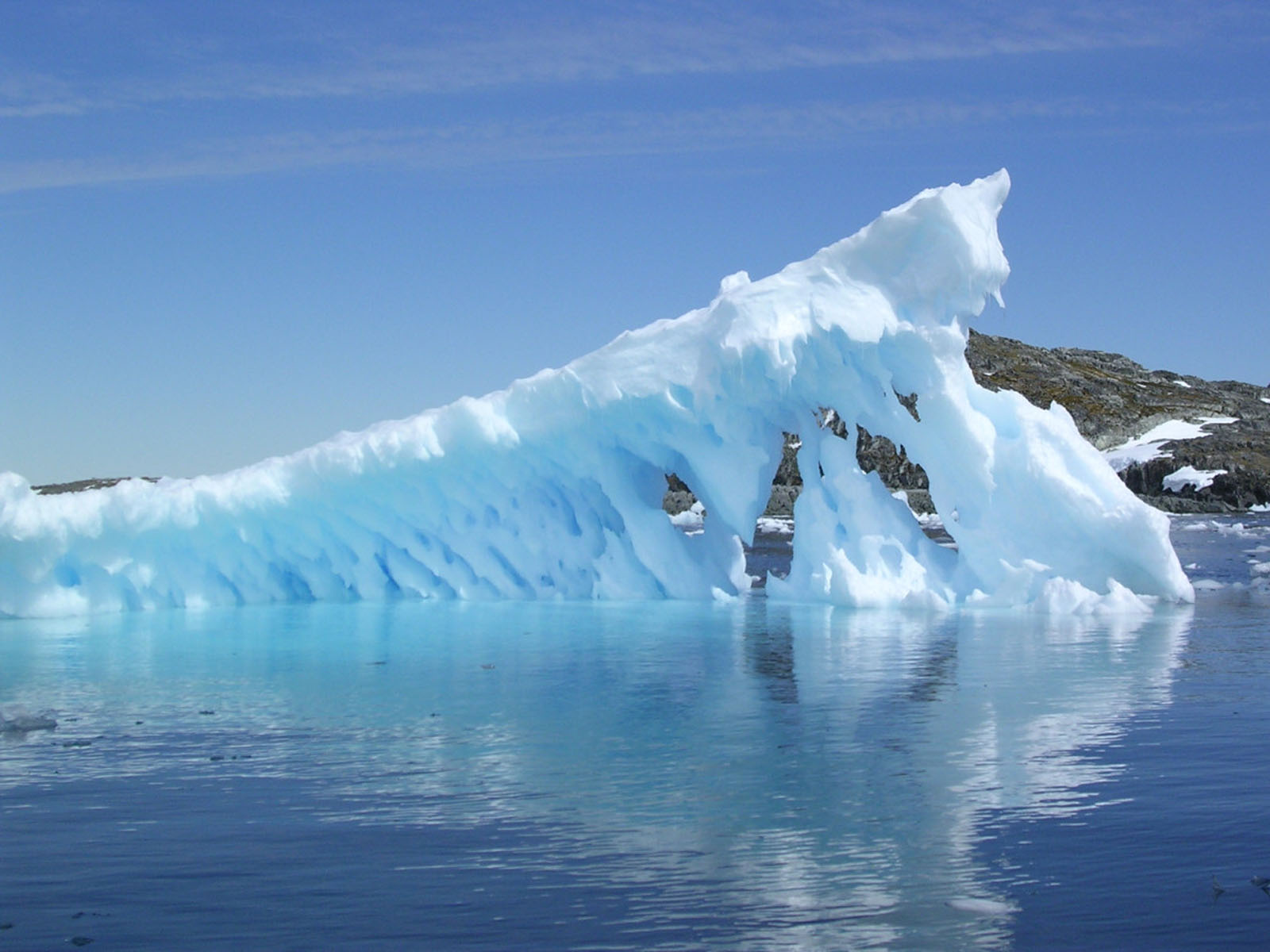 How Is Worldwide Sea Level Rise Driven by Melting Arctic Ice?