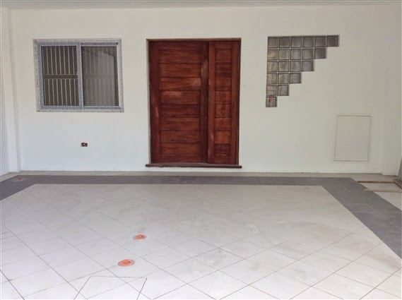 townhouse for sale in Quezon City front door and 2 car garage