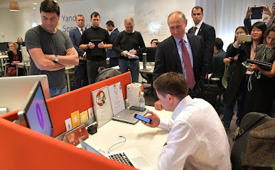Vladimir Putin in Yandex office, watching at the voice assistant Alice.