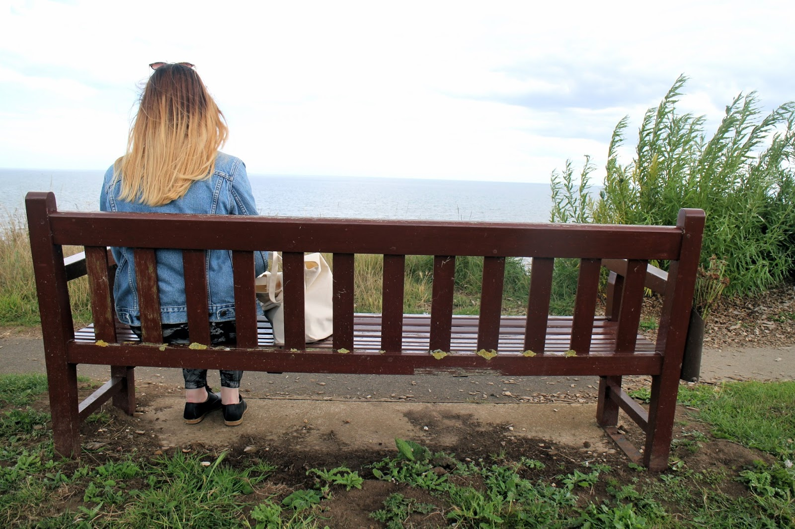 Bridlington - View of girl on bench at the East Yorkshire coast
