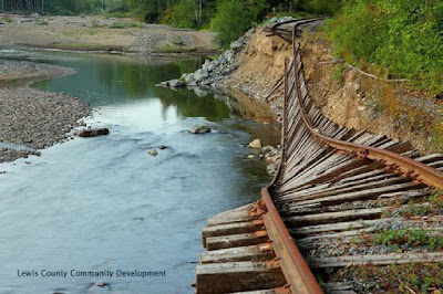 Erosion of the Tilton River bank in Morton has caused a section of a  historic railroad track to fall into the river. Removing the track and restoring the river bank is a priority project identified by the City's Shoreline Restoration Plan.