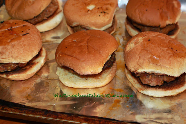 this is a delicious homemade sausage and how to make homemade sausage on a slider bun. The sandwich is on aluminum foil for easy reheating with mushrooms, a sausage pattie and slider bun