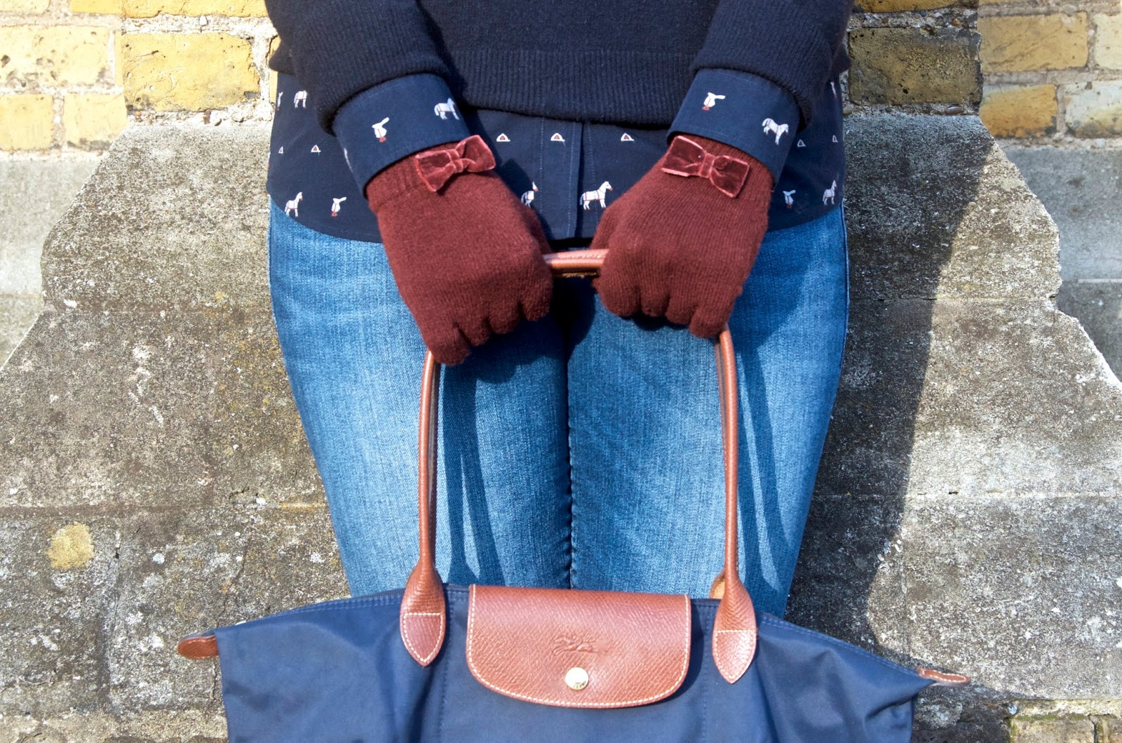 Maroon bow gloves, navy bag, horse print shirt and navy sweater