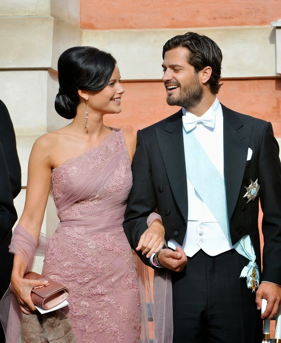 Swedish Prince Carl Philip, right, and Sofia Hellqvist, left, in this Aug. 31, 2013 file photo. The couple announced their engagement at a press conference at The Stockholm Palace, Friday, June 27, 2014.