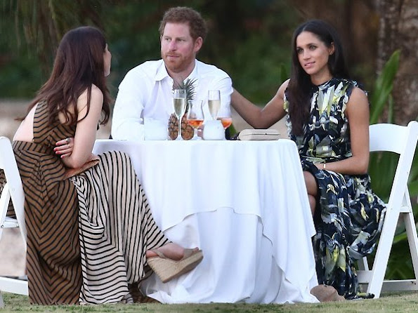 Prince Harry went to Jamaica in order to attend the wedding ceremony of the couple Tom Inskip and Lara Hughes-Young. Meghan Markle wore a bird printed silk maxi dress by Erdem Pre fall 2017 collection