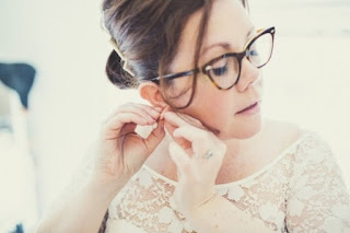 Your glasses should complement your dress and vice versa - Wedding Soiree Blog by K'Mich, Philadelphia's premier resource for wedding planning and inspiration - bride wearing glasses on her wedding day