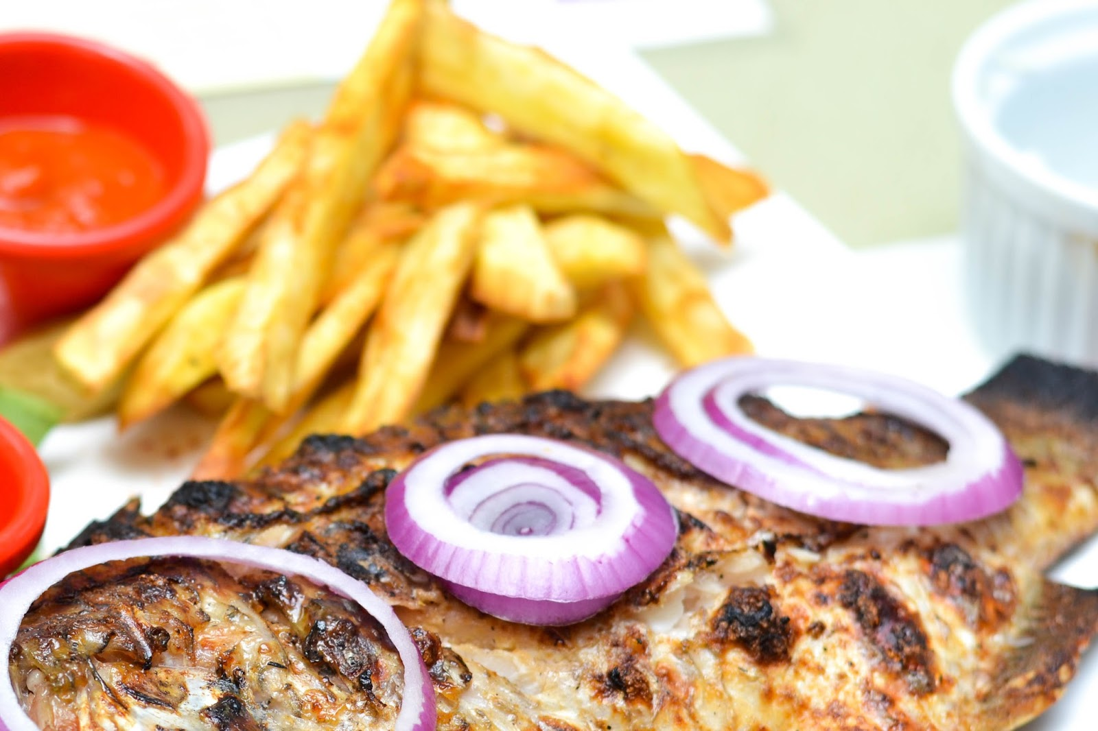 Grilled Fish with Red Onions on top