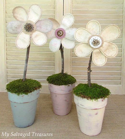 turn old baseballs into flowers and display in painted pots
