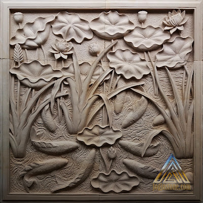 Relief batu alam paras putih motif lotus dan sembilan koi