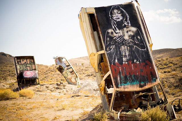 "On a whim, and perhaps out of a mix of boredom and curiosity, Oakland artists Nite Owl and Eddie Colla loaded up their car and drove 10 hours to the ""International Car Forest of the Last Church"" in Goldfield Nevada."
