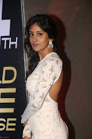 Chandini Chowdary in white Tight dress at Shamanthakamani pre release function ~  Exclusive 025.JPG